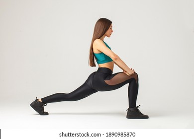 sportive woman doing stretching lunge exercise isolated on white background