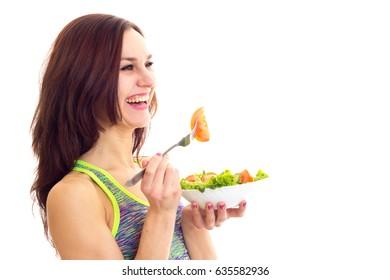 Sportive woman holding salad