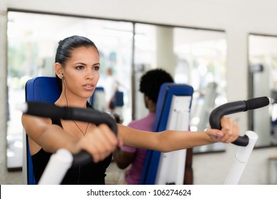 Sports activity, young man and woman exercising and working out in fitness gym