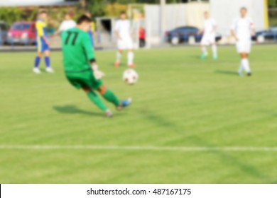 Sports background blur. Bokeh spectacular game of football as backdrop for sporting poster. Typical scene of game of football blurred background without focus for screen background