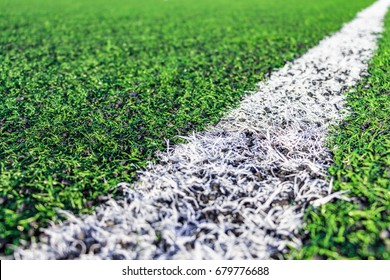 Sports background with copy space. Close up grass field.