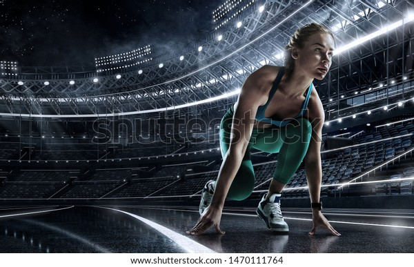 Sports background. Runner on the start line of the glowing stadium . Futuristic running track. Dramatic picture.