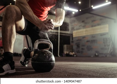 Sports background. Young athlete getting ready for crossfit training. Powerlifter hand in talc preparing to bench press.