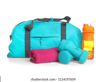 Sports bag and gym stuff on white background