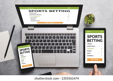 Sports betting concept on laptop, tablet and smartphone screen over gray table. Flat lay