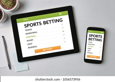 Sports betting concept on tablet and smartphone screen over gray table. All screen content is designed by me. Flat lay