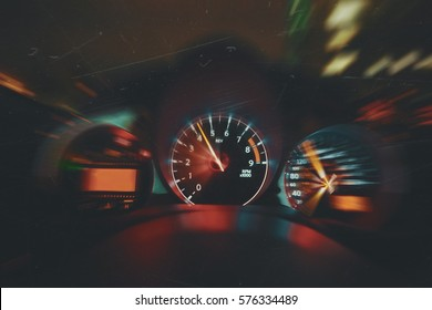 Sports Car Drives Fast at Night, Shows Interior of Car Including Speedometer and Tachometer