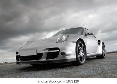 Sports car under storm clouds