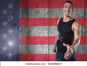 Sports coach shaking his hand against american flag