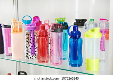 Sports colored plastic bottles for drinking water in the shop