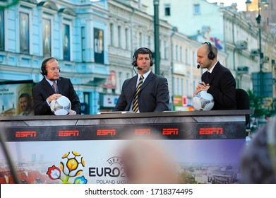 Sports commentators from ESPN channel holding soccer balls discussing the football match on the street. Euro-2012. July 1, 2012. Kiev, Ukraine