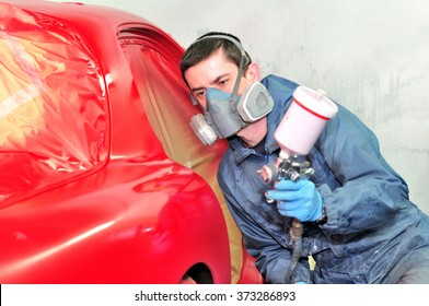 Sports coupe painting red by professional.