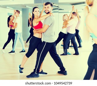 Sports dancing pair dance  together  in studio