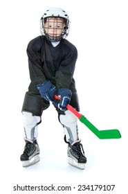 Sports development, training hockey, happy childhood concept.Little boy learning to play hockey.