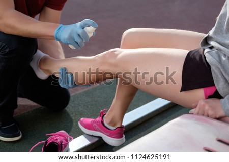 Sports Doctor Treating Injured Sportmans Knee Stock Photo (Edit Now ...