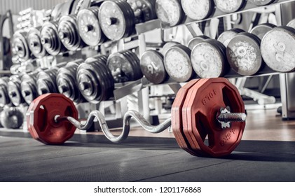 sports equipment in gym , barbell, horizontal photo
