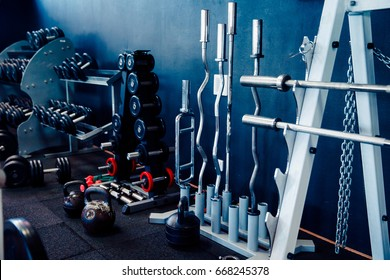 Sports equipment of the gym: barbell, rods, disks, weight, neck, dumbbells.
