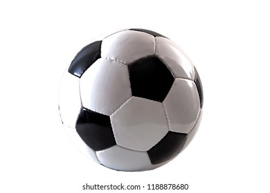 Sports equipment and leisure activity concept with a black and white generic classic leather football or soccer ball isolated on white background with a clip path cutout