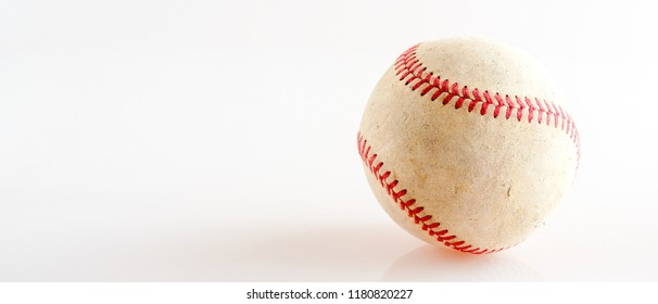 Sports Equipment old Baseball on white background