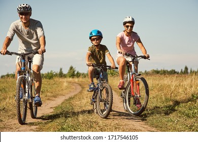 Sports family riding bicycles. Father, mother and son with bikes