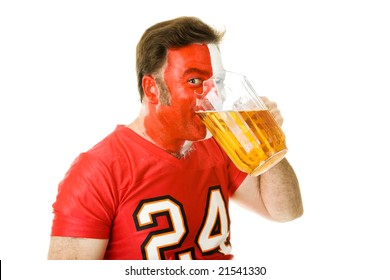 Sports fan guzzling a pitcher of beer.  Isolated on white.