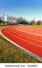 A sports field with a red running track