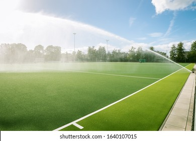 Sports field is watered by a sprinkler system