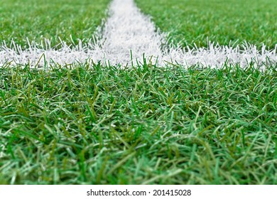 Sports field with white line markings.Small depth of field.