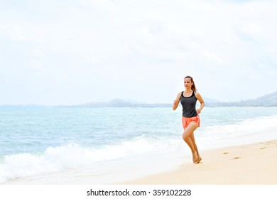 Sports. Fit Female Athlete Jogger Running On Beach. Sporty Athletic Woman Jogging During Workout Outside. Fitness, Exercising, Healthy Lifestyle. Health Concept