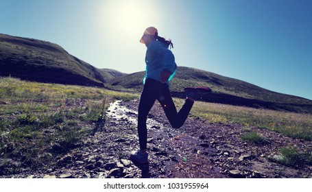 sports fitness woman trail runner running outdoors