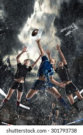 Sports, game, fighting, rain, stadium - Rugby players on a stadium