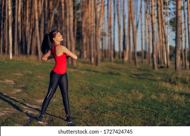 sports girl in the forest. morning exercises