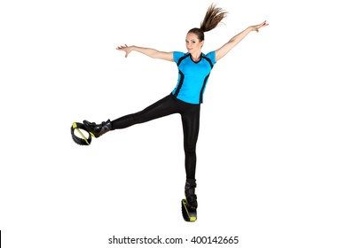 Sports girl in shoes for kangoo jumping isolated on white