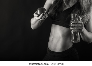 sports girl with water and apple