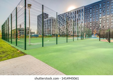 Sports ground in courtyard of residential complex. Public sports grounds for team games of sport, basketball, football, volleyball, handball in residential area, of educational institution Moscow 2019
