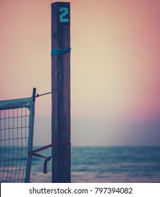 Sports Image Of A Beach Volleyball Net On A Californian Beach At Sunset With Copy Space