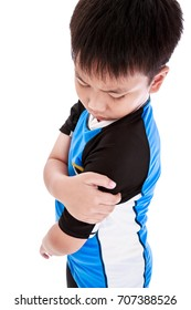 Sports injure. Asian child cyclist injured at shoulder. Sad boy looking at bruise with a painful gesture, isolated on white background. Human health care and problem concept. Studio shot.