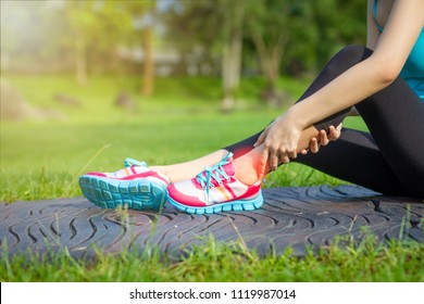 Sports injuries to women with joint ankle pain. Young woman exercise model