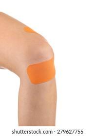 Sports injury - woman having pain in his knee making massage.