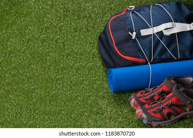 sports kit for extreme recreation in the wild, on a green lawn, with a place for an inscription