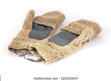 Sports Knitted mitten from a rough wool on a white background