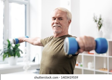 Sports lover. Nice active man practicing physical activities while enjoying sport