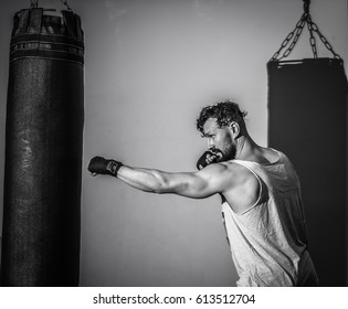 sports man Boxing bag in the gym,the concept of sport and health