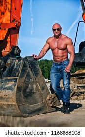 sports man near to the excavator