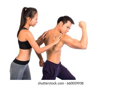Sports man and woman posing on a white background couple in sportswear. Fitness