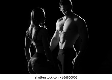 Sports man and woman. Silhouettes on a black background. black and white