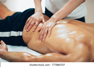 Sports massage. Therapist massaging lower back