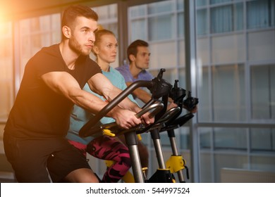 Sports people on stationary bike