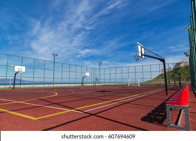 Sports playground for basketball and football by the sea