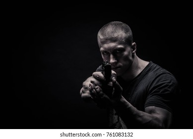 sports portrait of a male bodybuilder on black background, concept photo of healthy sport